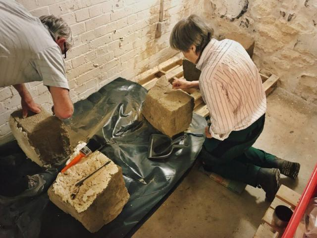 Conservator Sue Kelland and Heritage Centre Volunteer Dave Birch cleaning the stone.